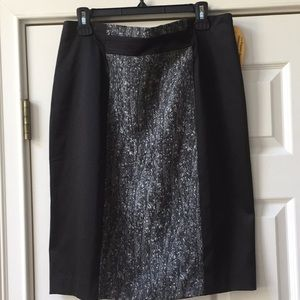 New/with Tags Black satin skirt with fabric  front